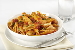 Pasta with tomato sauce. A tabletop view of a bowl of rigatoni or penne pasta with tomato sauce garnished with chopped parsley Royalty Free Stock Photo