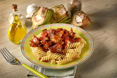 Pasta with tomato sauce and artichokes Royalty Free Stock Photo