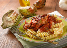 Pasta with tomato sauce and artichokes Royalty Free Stock Photography