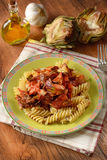 Pasta with tomato sauce and artichokes Stock Image
