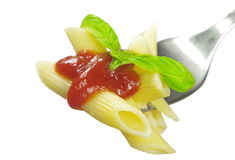 Pasta with tomato sauce and basil on fork Royalty Free Stock Images