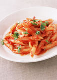 Pasta with tomato sauce basil and grated parmesan Royalty Free Stock Photography
