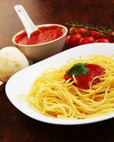 Pasta with tomato sauce basil and grated parsley Royalty Free Stock Images