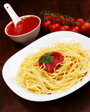 Pasta with tomato sauce basil and grated parsley Stock Photography