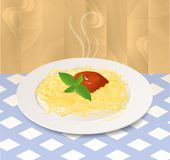 Pasta with Tomato Sauce and Basil on a Plate. Italian food. Plate with spaghetti on the table Royalty Free Stock Photo