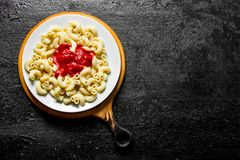 Pasta with tomato sauce. On black rustic background stock photos