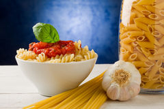 Pasta with tomato sauce on blue background Royalty Free Stock Photos