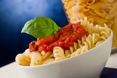 Pasta with tomato sauce on blue background Stock Images