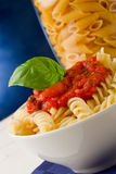 Pasta with tomato sauce on blue background Stock Photo