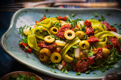 Pasta tomato sauce capers asparagus Magic light Royalty Free Stock Images