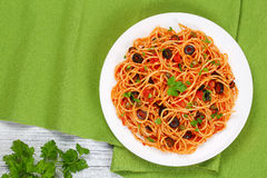 Pasta with tomato sauce, capers and olives Stock Photo