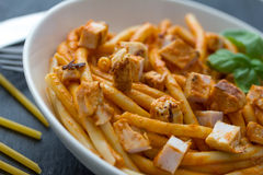 Pasta with tomato sauce and chicken breast Stock Photo