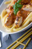 Pasta with tomato sauce and chicken breast Royalty Free Stock Photo