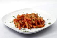 Pasta with tomato sauce and fresh herbs Stock Photos
