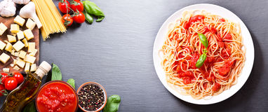 Pasta with tomato sauce with ingredients Royalty Free Stock Photos