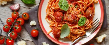 Pasta with tomato sauce and meatballs. On a dark background stock images