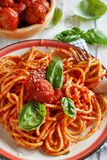 Pasta with tomato sauce and meatballs. On a dark background royalty free stock image
