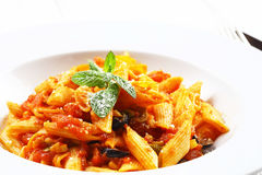 Pasta with tomato sauce and a mint.  Stock Image