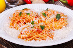 Pasta with tomato sauce, parmesan cheese and mint. Stock Photo