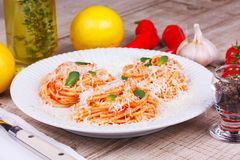 Pasta with tomato sauce, parmesan cheese and mint. Stock Photos