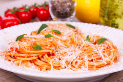 Pasta with tomato sauce, parmesan cheese and mint. Stock Photography