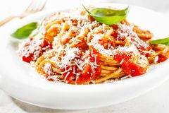 Pasta with tomato sauce and parmesan royalty free stock photography
