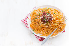 Pasta with tomato sauce and parmesan on white wooden background Stock Photos