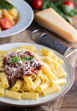 Pasta with tomato sauce and parmigiano on natural wooden table. Royalty Free Stock Photo