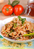 Pasta with tomato sauce, peas and bacon Stock Image