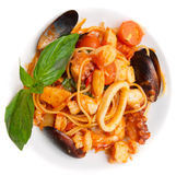 Pasta with tomato sauce and seafood in plate Royalty Free Stock Image