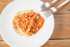 Pasta with tomato sauce on wooden table Stock Photos