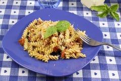 Pasta with tomato and sausage Stock Photos