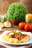 Pasta with tomato, sausage and ricotta Stock Images