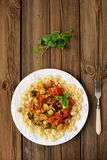 Pasta with tomato sause. On wooden background Stock Image