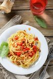 Pasta with tomato slices and mushrooms Stock Photos