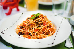 Pasta with tomato souce and olives Stock Images