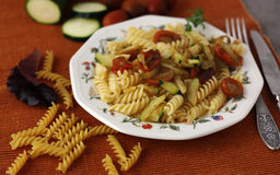 Pasta with tomato and zucchini. A pasta with tomato and zucchini Royalty Free Stock Photo