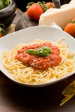 Pasta with tomatoe sauce and ingredients Stock Photo