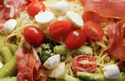 Pasta with tomatoes, asparagus and ham Royalty Free Stock Photo