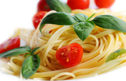 Pasta with tomatoes and basil Stock Photos