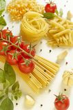 Pasta with tomatoes and basil Stock Images