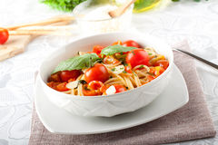 Pasta with tomatoes and basil. On complex backgorund Stock Photo