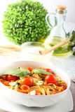 Pasta with tomatoes and basil Royalty Free Stock Image