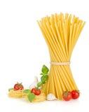 Pasta, tomatoes, basil and garlic Royalty Free Stock Photos