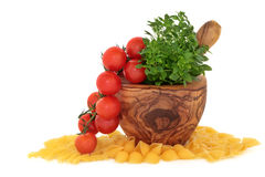 Pasta, Tomatoes and Basil Herb Royalty Free Stock Photography