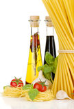 Pasta, tomatoes, basil, olive oil etc Royalty Free Stock Photos