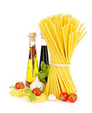 Pasta, tomatoes, basil, olive oil, vinegar, garlic and parmesan Stock Photography