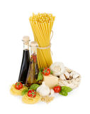 Pasta, tomatoes, basil, olive oil, vinegar, garlic and parmesan Royalty Free Stock Photos