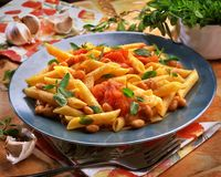 pasta with tomatoes and beans in a plate on a table royalty free stock photo