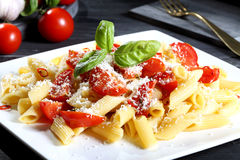 Pasta with tomatoes and cheese Royalty Free Stock Photo